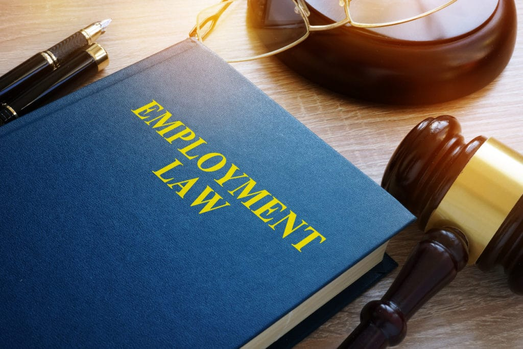 Employment law concept. Book and gavel on a desk.